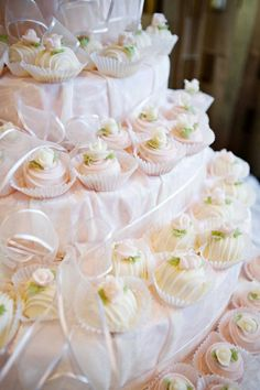 Looks like a beautiful and easy way to display and serve petit fours.  Cover sized styrofoam, add ribbon and serve goodies in pretty papers.
