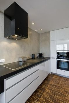 minimalistic kitchen...no overhead cupboards is good