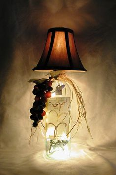 """TUSCANY WINE BOTTLE LAMP.  Lively wine bottle lamp made from a recycled Prendo Pinot Grigio wine bottle.  The bottle is clear and the lamp shade is brown.    Lamp is approximately 15"""" tall and approximately 7 """" wide.  It has a nite light under the shade and mini lights inside the bottle.  Comes with a long, switched cord for convenience.  $30.00"""