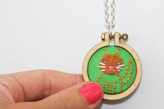 Cat embroidered hoop necklace - SQUIGGLES by name - cute by nature - ginger cat on green - made by dandelyne $40