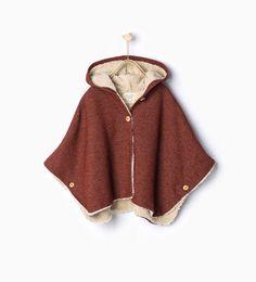 Mantello intenro in lana di montone