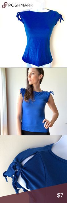 Wet seal blue blouse, stretchy material Gently used. Some discoloration as pictured. Super cute top though. Not very noticeable when wearing. Wet Seal Tops Blouses