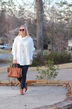 Poncho Denim and Cognac (Trendy Wednesday Link-up #104) wearing an outfit idea of a sweater poncho, skinny jeggings jeans, white tee, handbag, ankle booties boots and lariat necklace.