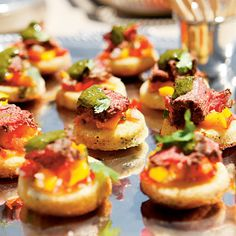 Beef Tenderloin Crostini   This melt-in-your-mouth appetizer will be the standout of your party thanks to the ensemble of perfectly seasoned layers and, of course, the grilled tenderloin. Prep the Herbed Cornbread Crostini base up to a month ahead and freeze.
