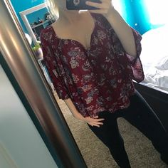 Abercrombie floral top Maroon top with beautiful bell sleeves (half sleeves). Fits loose so the top could fit a small or medium. Worn maybe twice :-) Abercrombie & Fitch Tops Blouses