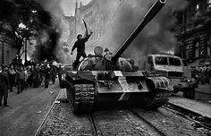 August 1968 in Prauge, photographer Josef Koudelka takes a picture of a man standing on top of a tank during a riot