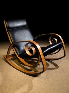 George Mulhauser; #Y038 Bent Laminated Wood and Leather Rocking Chair for Plycraft, c1965.