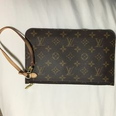 New Louis Vuitton clutch New Louis Vuitton clutch. Part of the neverful bag I bought last year. From the Santa Monica store. I have the authentication paperwork for it. Retail is 375 Louis Vuitton Bags Clutches & Wristlets