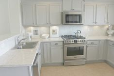 Serene Nordic French Kitchen with Grey Cabinets, Soprano quartz countertop and backsplash. Come read about Hello Lovely's Before and After DIY Serene Kitchen Makeover: Smart Upgrades, No Demo or Dust! Condo Kitchen, Smart Kitchen, Kitchen Redo, Kitchen Remodel, Kitchen Black Counter, Grey Kitchen Cabinets, Small Bedroom Furniture, Kitchen Furniture, Fixer Upper Kitchen