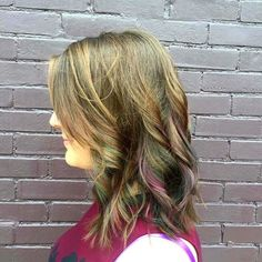 "A little wind blown ""oil slick"" through the ends of this babes hair!!!!! #oilslickhair #trimlegendarybeauty #goldwell #elumen @trimnashville @goldwellkmsacademy"