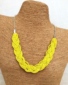 ***Please see shop announcements for current processing time.... Wedding season is upon us... If you are purchasing multiple items for a bridal party order or otherwise please convo me to set up a custom listing...Thank you...***   This stunning new beauty necklace is a real eye catcher! In the perfect shade of bright sunny yellow and silver this braided bib will compliment any outfit. It features nine strands of seed beads and a nickel free silver chain and clasp. This necklace is the…