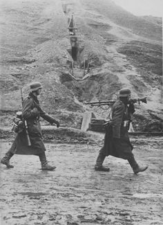 Two German soldiers on the road over a hill on the Eastern Front, 1942