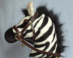 Hobby horse, stick horse, Zebra. Top quality sturdy zebra with hardwood pole, handle and wheels and a removable leather bridle