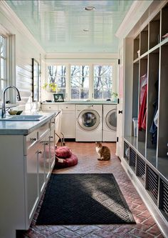 wonderful laundry room! Brick floor and blue ceiling :)