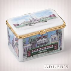 """The Grand Tour"" box delicately displays all of her favorite New Orleans landmarks including St. Louis Cathedral, the St. Charles Avenue Streetcar, the French Quarter and the Mississippi River. $35.00"