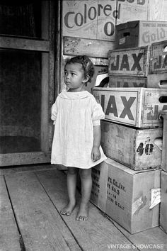 Found photo of a serious little girl. Is that JAX BEER in the crates?