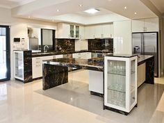 Another stunning kitchen design with Cosmic Black Polished Granite. Stone Bench, Black Polish, Travertine, Cosmic, Granite, Natural Stones, Kitchen Design, Barn, Home Decor