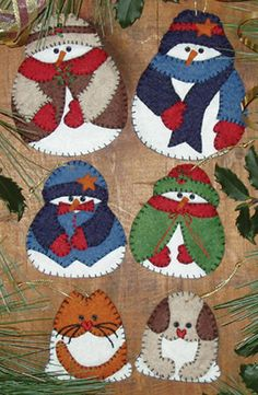 Snow Folk Ornament Kit... but these guys would be cute made into a couple throw pillows to help celebrate the season.