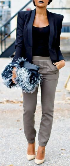 26 Great Fall Outfits: Ideas To Try Already This Autumn/Winter Season: Woman on the sidewalk wearing gray pants, black top, navy blue boxy blazer and pointy white stiletto heels