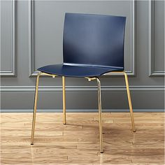 slim style. Endowed derriere and curved square-cut back fit to form in pliable slim navy Hirek ® techno-polymer composite.  The back even gives a little when you rock back.  Brass-plated metal legs add shine, right on trend. Formed Hirek ® plastic seatSteel tube legs with brass finishStacks up to 4 highAssembly requiredMade in Italy.