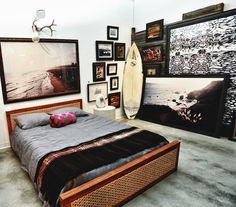 Surf inspired bedroom...love the oversized prints if a bit busy for the sleeping place.