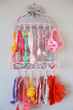 Umm I totally want this!!Bird cage hair band organizer. If you see a cute small bird cage please let me know. I will probably have you buy it for me. -Sofia