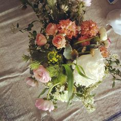 linen table cloth and natural flowers