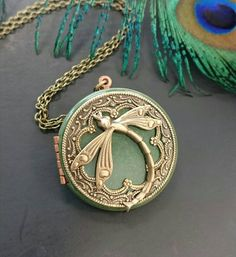 Check out this item in my Etsy shop https://www.etsy.com/listing/226025665/dragonfly-locket-pendant-necklace