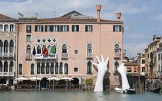 Artist Lorenzo Quinn (previously) just finished the installation of a monumental sculpture for the 2017 Venice Biennale. Titled Support, the piece depicts a pair of gigantic hands rising from the water to support the sides of the Ca' Sagredo Hotel, a visual statement of the impact of climate change