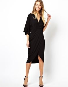Great dress for any evening wedding. Great for column or straight body shapes. Will even conceal a tummy.