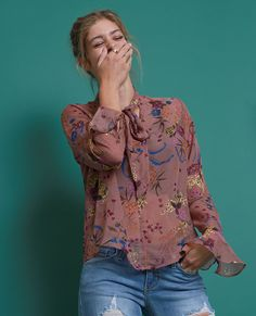 +Non-stretchy sheer multicolor floral printed blouse features plunging neckline with pussy bow sash detail