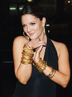 Get the Look: Drew Barrymore's Bold Gold Bangles http://stylenews.peoplestylewatch.com/2007/02/14/get-the-look-dr-2/