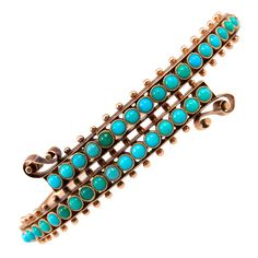 Victorian. 18k Gold and Turquoise Crossover Bracelet, c1880.