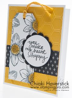 """2015 uses products that aren't featured in the new 2015-2016 catalog so get them while you can. Petal Potpourri and Lovely, Amazing You stamp sets; Basic Black and Hello Honey inkpads and cardstocks; Stacked with Love DSP; Honeycomb TIEF; Angled Tag Topper, 2"""" Circle and 2-3/8"""" Scallop circle punches."""