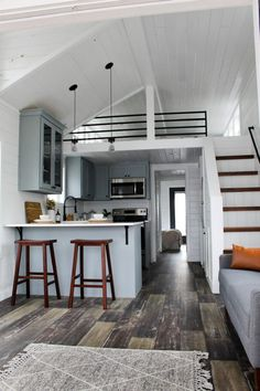 This is the Zion Park Model Tiny House by Mustard Seed Tiny Homes. It features a large covered porch that's built right into the unit. Inside, you've got a full-size main-floor bedroom,… homes The Zion Park Model Tiny House by Mustard Seed Tiny Homes Best Tiny House, Modern Tiny House, Tiny House Cabin, Tiny House Living, Small House Design, Tiny House Plans, Small Living, Living Area, Tiny House With Loft