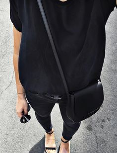 Loose black t-shirt + black skinny denim + black two strap sandals + Knomo + Liz Clairborne sunglasses