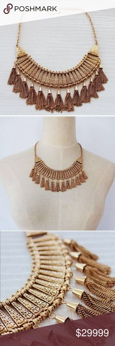 Coming SoonNew Multi Tassel Gold Bib Necklace New gold plated multi tassel statement necklace with beautiful details along the necklace, making it unique. Bundle & Save Jewelry Necklaces