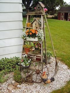 A rustic vertical ladder garden stacked with treasures. | The Micro Gardener