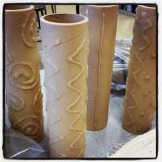Hot glue on thick cardboard tubes as rollers for clay!