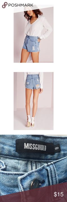 Ripped high waisted denim shorts These high waisted shorts are in a lovely wash. The distress adds great texture to the design and the cheeky rip at the back makes it sexy. Pair with a plain white tee for a casual look or with a silky top and heels to make it more formal. 💕 UK 8/ US 4 Missguided Shorts Jean Shorts