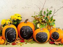 Great Idea from Boston.com - Make a pumpkin family portrait — no carving! — and other simple but eye-catching fall tabletop, mantel arrangements or by your front door!