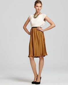 Great for those summer days. Make sure your skirt is at the knee level to be office appropriate.