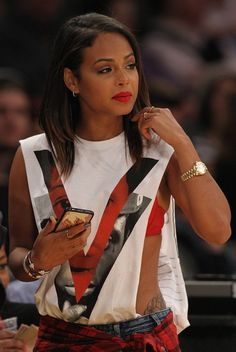 Christina Milian supporting her man by wearing his shirt!