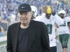 Phil Knight wearing his own Nike embroidered hat. Phil Knight, Embroidered Hats, Clothing Logo, Miuccia Prada, Rich People, 21st, Company Logo, Retail, Blazer