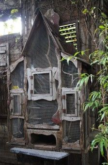 Chicken Gnomes live here. You could do this with old cabinets, add screens to the doors.
