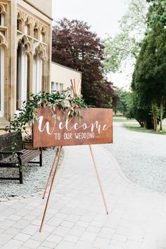 Wooden Welcome Sign with Greenery Garland | Greenery & White Marquee Wedding at The Villa, Levens with Copper Details | Bowtie and Belle Photography