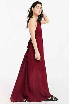 Band Of Gypsies Grecian High-Neck Crepe Maxi Dress  |  A crepe maxi dress from Band Of Gypsies. Cut long in a relaxed fit featuring a banded waist and a high neckline with straps that criss-cross and tie at the open back. | Medium: Polyester | Design: Band of Gypsies for Urban Outfitters ($79.00)