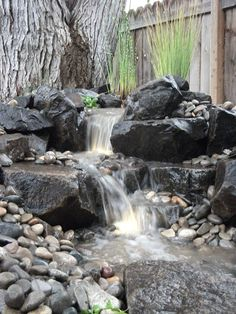 Waterfall created by Aquascape by Blue Creek. #WaterfallWednesday.