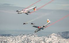 Skydivers 'fly' in formation with gliders in daring stunt over the Alps. At speeds of up to 120mph the skydivers, wearing specially-designed aerodynamic winged suits, fly alongside the planes.