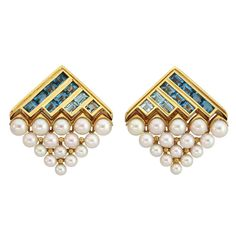 From Waldmann Inc:  BULGARI Earclips  A pair of 18 karat yellow gold modern ear clips set with aquamarines and pearls